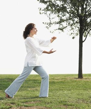 Woman practicing tai chi